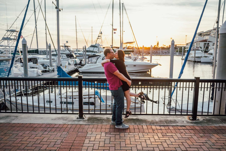 Romantic sunset engagement session with sailboats at Palafox pier marina.