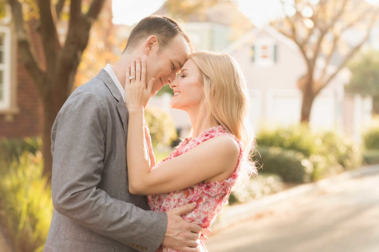 bright and airy engagement photo in downtown pensacola with gorgeous blond in a pink sundress