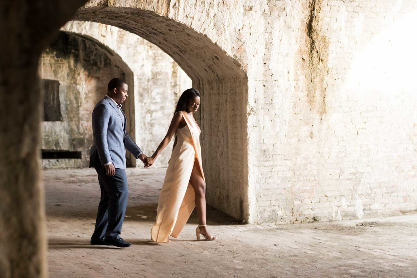 black bride and groom's fort pickens pensacola beach engagement session with old brick